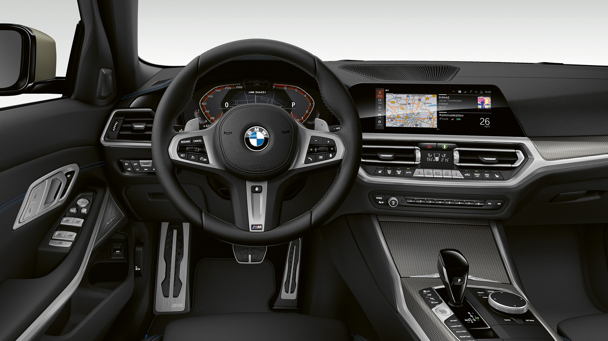 Frontal close-up of the driver's cockpit of the BMW 3 Series M340i xDrive Sedan.